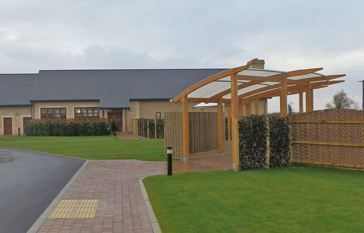 Sedgemoor Crematorium curved floral tribute Fordingbridge
