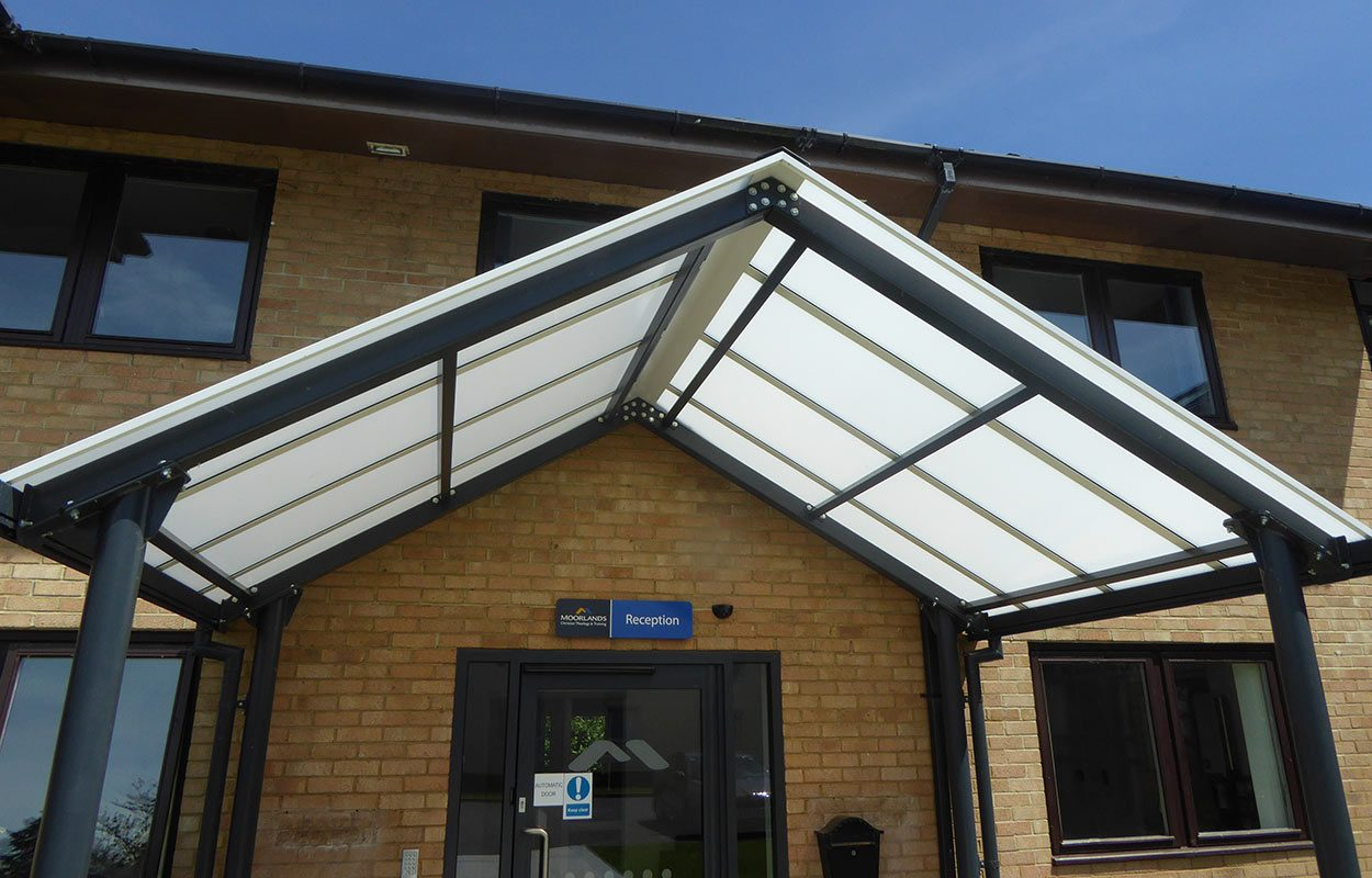 Fordingbridge mono pitch entrance steel canopy Moorlands College