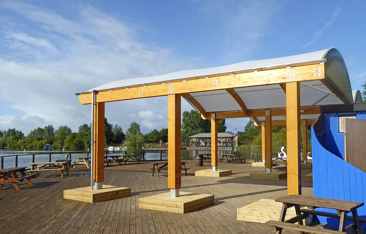 Fordingbridge twin span barrel vaulted timber canopy at Cotswold Country Park and Beach