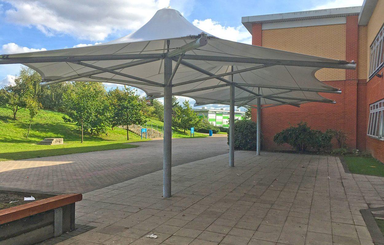 Cumberland school Fordingbridge triple conic tensile canopy