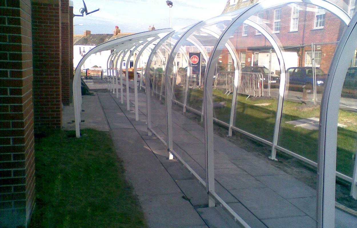 Sainsburys covered walkway & trolley park